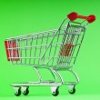 Shopping cart against the background — Stock Photo #5903208
