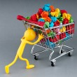 Stock Photo: Recylcing concept with color paper and shopping cart