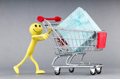Smileys with gift box in the shopping cart — Stock Photo