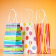Shopping bags against gradient background - Stok fotoğraf