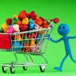 Recylcing concept with color paper and shopping cart - Stok fotoğraf