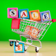 Shopping cart against the background — Stock Photo #5984739