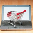 Stock Photo: Internet online shopping concept with computer and cart