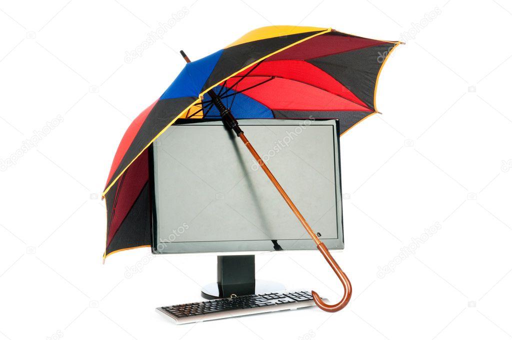 Computer Under Protection Of Umbrella Stock Photo