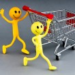 Happy family with shopping cart - Photo