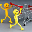 Happy family with shopping cart — Stock Photo #6016682