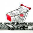 Internet online shopping concept with computer and cart — Stock fotografie