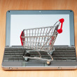 Internet online shopping concept with computer and cart — Foto de stock #6024251