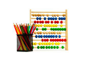 Abacus and pencils isolated on white — Stock Photo