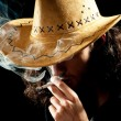 Man in cowbow hat smoking — Stock Photo