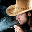Man in cowbow hat smoking — Stock Photo #6081907