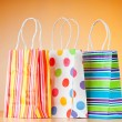 Shopping bags against gradient background — Stock Photo #6082131