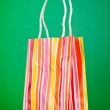 Colourful paper shopping bags against gradient background — Stock Photo #6082302