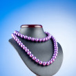 Pearl necklace against gradient background — Stock Photo #6082664