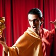 Stock Photo: Actor with maks in funny theater concept