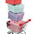 Shopping cart and giftboxes on white - ストック写真