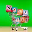 Shopping cart against the background — Stock Photo #6083268