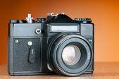 Vintage film camera against gradient background — Stock Photo