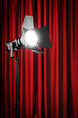 Curtains and projector lights wtih space for your text — Stock Photo
