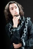 Man with metal chain around him — Stock Photo