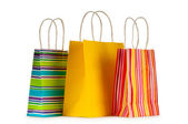 Colourful paper shopping bags isolated on white — Stok fotoğraf