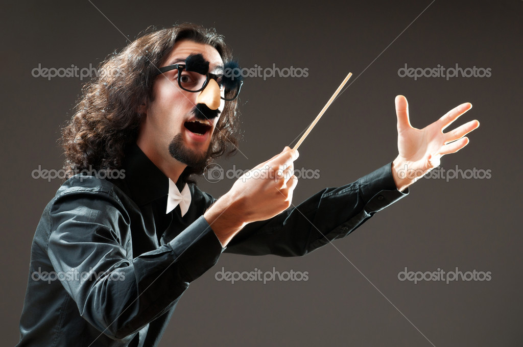 Funny conductor against dark background — Stock Photo #6082262