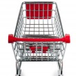 Shopping cart against the white background — Stock Photo