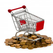 Gold coins in shopping cart — Stock Photo