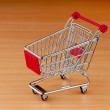 Shopping cart against the  background — Stock Photo #6208218