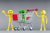 Happy family with shopping cart — 图库照片