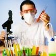 Stock Photo: Chemist in the lab experimenting with solutions