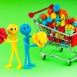 Recylcing concept with color paper and shopping cart — Stock Photo #6274359