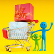 Smileys with gift box in the shopping cart - Stock Photo
