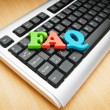 FAQ concept with letters on keyboard - Stock fotografie