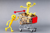 Happy family with shopping cart — Stock Photo