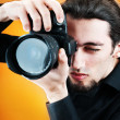 Photographer with the digital camera — Stock Photo #6281133