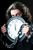 Man chained to the clock — Stock Photo