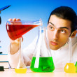 Chemist in the lab experimenting with solutions — Stock Photo