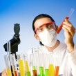Chemist in the lab experimenting with solutions — Stock Photo #6327750