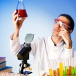 Chemist in the lab experimenting with solutions — Stock Photo #6328011