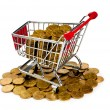 Gold coins in shopping cart - Stok fotoraf