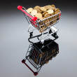 Gold coins in shopping cart - Foto de Stock  