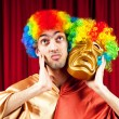 Stok fotoğraf: Actor with maks in a funny theater concept