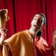 Actor with maks in a funny theater concept — Stock fotografie #6336475