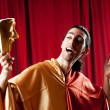 actor with maks in a funny theater concept — Stock Photo #6336475