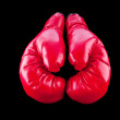 Stock Photo: Red boxing gloves isolated on black