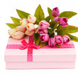 Stock Photo: Flowers and gift box isolated on white