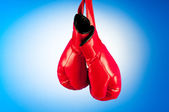 Red boxing gloves on the background — Stock Photo