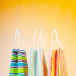 Shopping bags against gradient background - Lizenzfreies Foto
