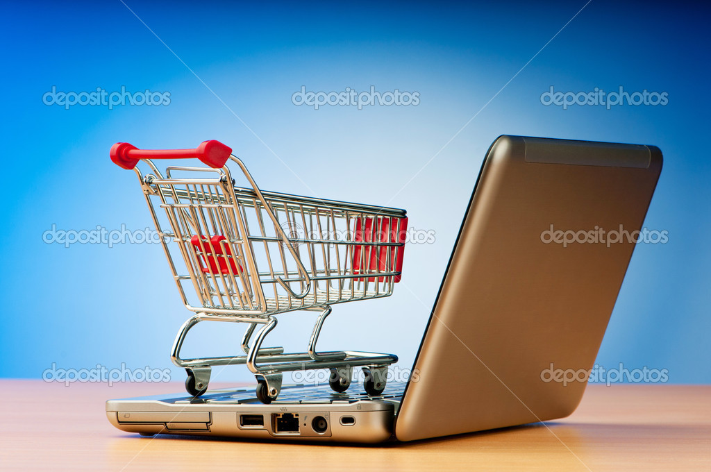 Internet online shopping concept with computer and cart — Lizenzfreies Foto #6350698